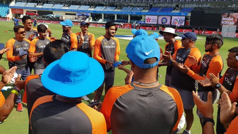 India's Khaleel Ahmed being handed his ODI cap by Rohit Sharma in Dubai.