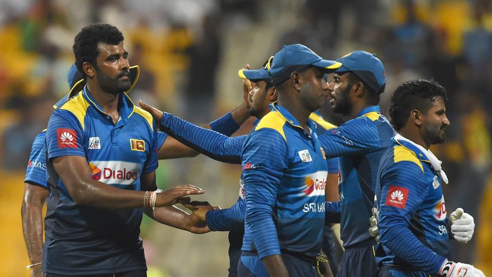 Sri Lankan cricketer Thisara Perera (L) celebrates with teammates after he dismissed Afghan batsman Mujeeb Ur Rahman. (AFP)
