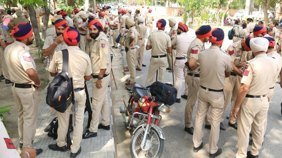 Police force deployed at Government Polytechnic College in Bathinda  ahead of the polls. A total of 17,268 polling booths will be set up and 86,340 personnel will be put on the election duty. Thirty-five observers will be appointed to ensure peaceful conduct of the polls, State election commissioner Sandhu told PTI.  (Sanjeev Kumar/HT)