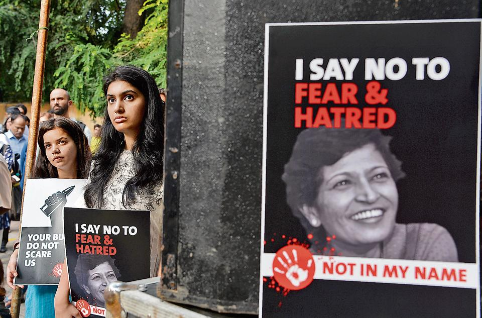 Demonstrators hold up placards against the murder of journalist Gauri Lankesh during a 'Not In My Name' protest in New Delhi on September 7, 2017.