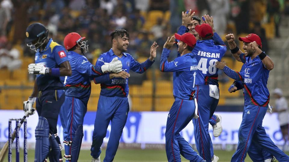 Afghanistan's Rashid Khan, third left, celebrates with teammates the dismissal of Sri Lanka's Shehan Jayasuriya. (AP)