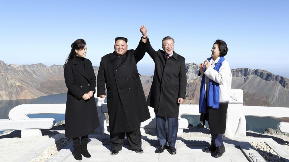 South Korean President Moon Jae-in (2nd-R), and his wife Kim Jung-sook (R), stand with North Korean leader Kim Jong Un (2nd-L), and his wife Ri Sol Ju on Mount Paektu in North Korea. There is no more sacred place in North Korea than Mount Paektu —and getting the South Korean President to such a spot is a propaganda coup unlike any other. (Pyongyang Press Corps Pool via AP)
