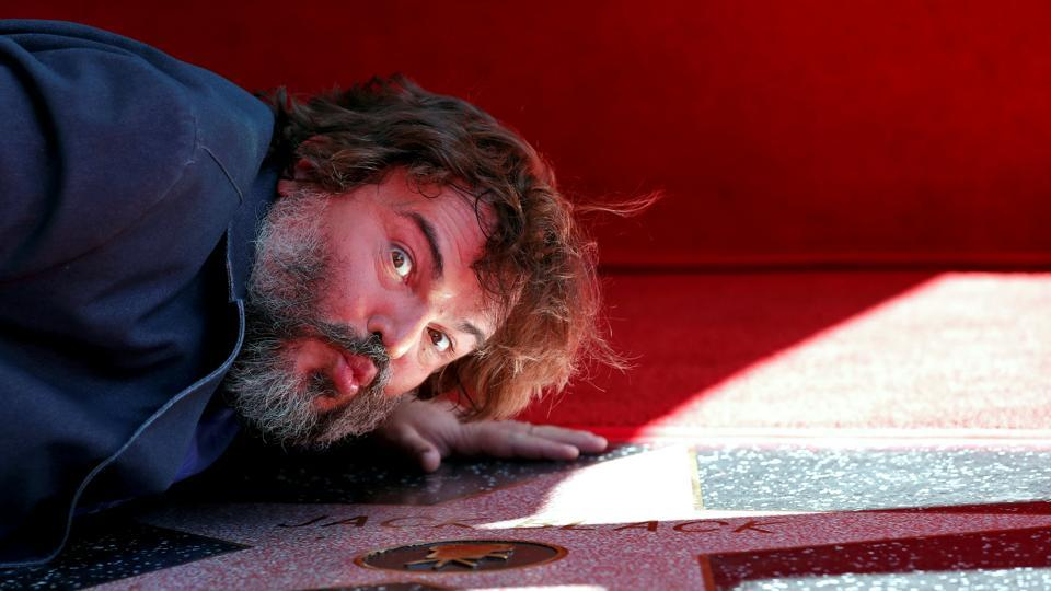 Actor Jack Black kisses his star at its unveiling on the Hollywood Walk of Fame in Los Angeles, California. (Mario Anzuoni / REUTERS)