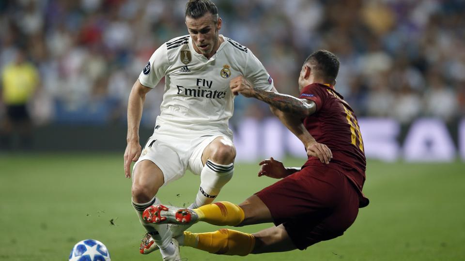 Real midfielder Gareth Bale (L), duels for the ball with Roma defender Aleksandar Kolarov during a Group G Champions League soccer match between Real Madrid and Roma at the Santiago Bernabeu stadium in Madrid, Spain. (Manu Fernandez / AP)