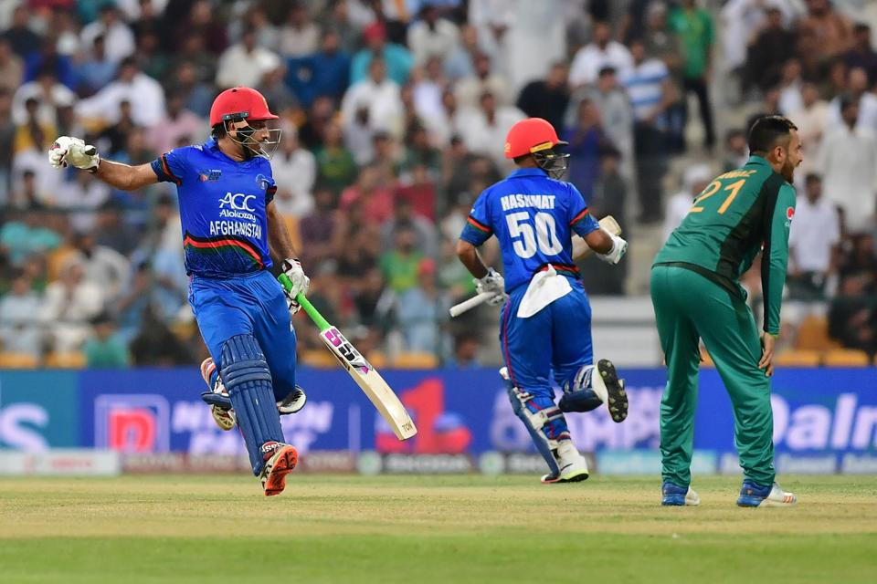 Afghanistan team captain and batsman Mohammad Asghar (L) runs between the wickets during the one day international. (AFP)