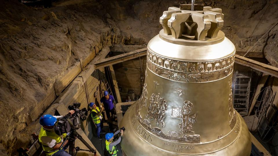 A picture released by the communication services of the foundry in Przmysl shows the world's largest bell, weighing 55 tons, during its unveiling ceremony at the Metalodlew foundry in Krakow, Poland. The bell is destined for the Basilica of the Eternal Divine Father in Trinidade, a major pilgrimage site in Brazil. (Dominik Gajda / Foundry Pres Office / AFP)