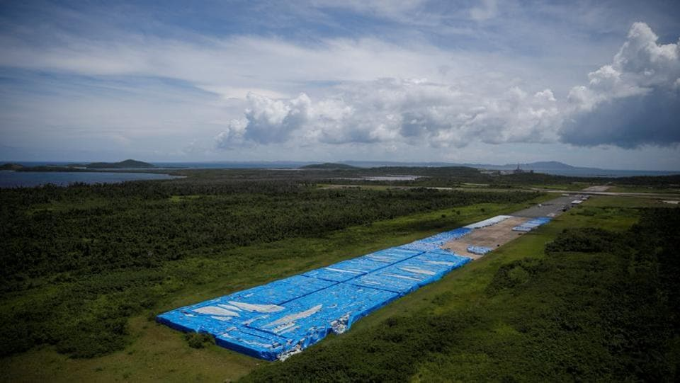 About 20,000 pallets of unused water bottles are seen along an aeroplane runway a year after Hurricane Maria devastated Puerto Rico in Ceiba, Puerto Rico. (Carlos Barria / REUTERS)