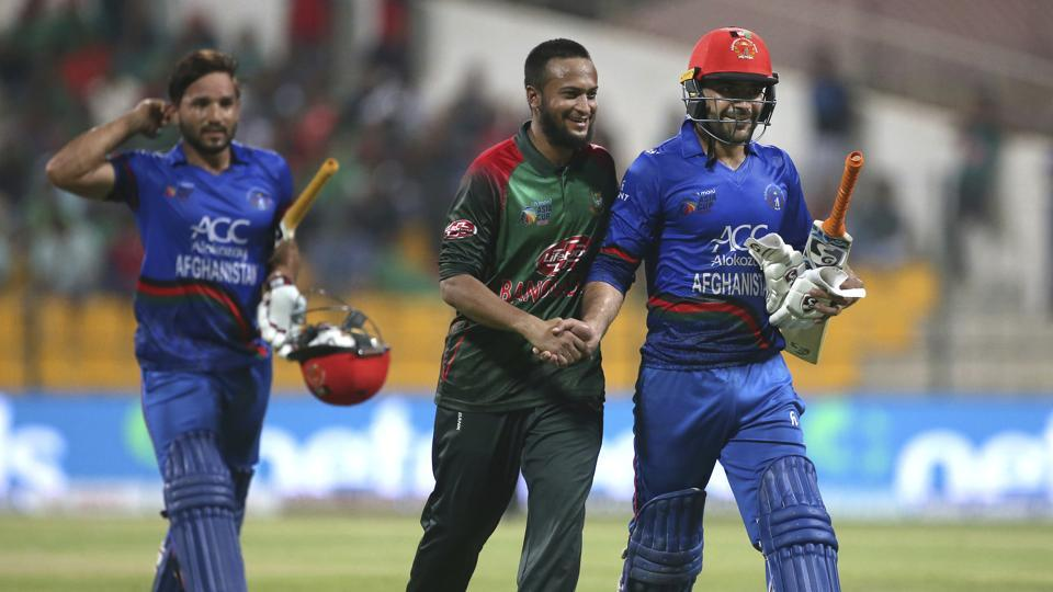 Bangladesh's Shakib Al Hasan, center, congratulates Afghanistan's Rashid Khan, right, on scoring fifty runs during the one day international cricket match of Asia Cup between Bangladesh and Afghanistan in Abu Dhabi. (AP)