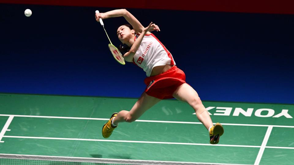 Japan's Aya Ohori returns a shot against her compatriot Nozomi Okuhara during the women's semi-final match at the Japan Open Badminton Championships in Tokyo. (Kazuhiro Nogi / AFP)