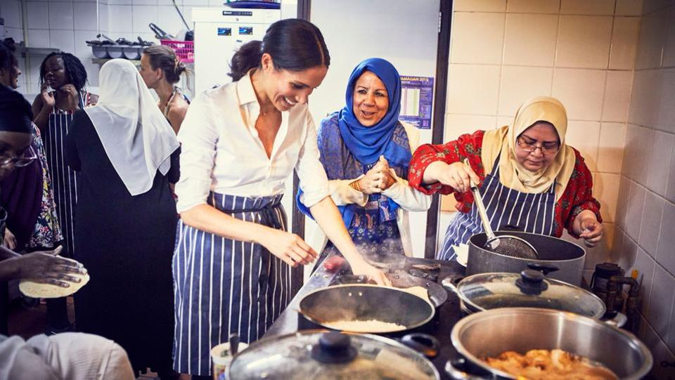 Meghan, Duchess of Sussex, cooks with women in the Hubb Community Kitchen at the Al Manaar Muslim Cultural Heritage Centre in West London, in the aftermath of the Grenfell Tower fire. (Jenny Zarins / Kensington Palace / AFP)