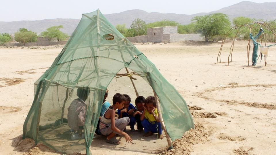 Displaced Yemeni children from Hodeida play in a shelter at a makeshift camp in a village in the northern district of Abs in Hajjah province, Yemen. (Essa Ahmed / AFP)