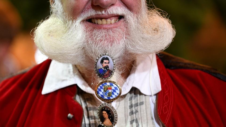 A visitor poses for a picture during the 185th Oktoberfest in Munich. (Andreas Gebert / REUTERS)