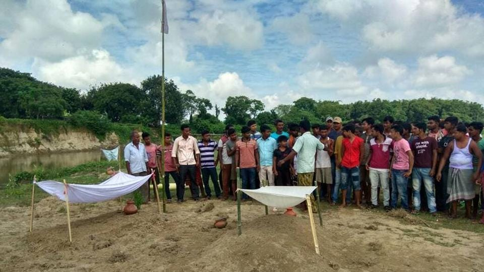 Villagers and family members of the two victims, Rajesh Sarkar, 19, and Tapash Burman, 21, have refused to cremate the bodies.