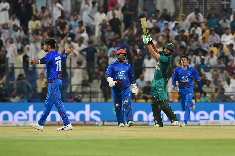Afghanistan's Rashid Khan (L) celebrates after he dismiss Pakistan's Mohammad Nawaz (R) during the one day international. (AFP)
