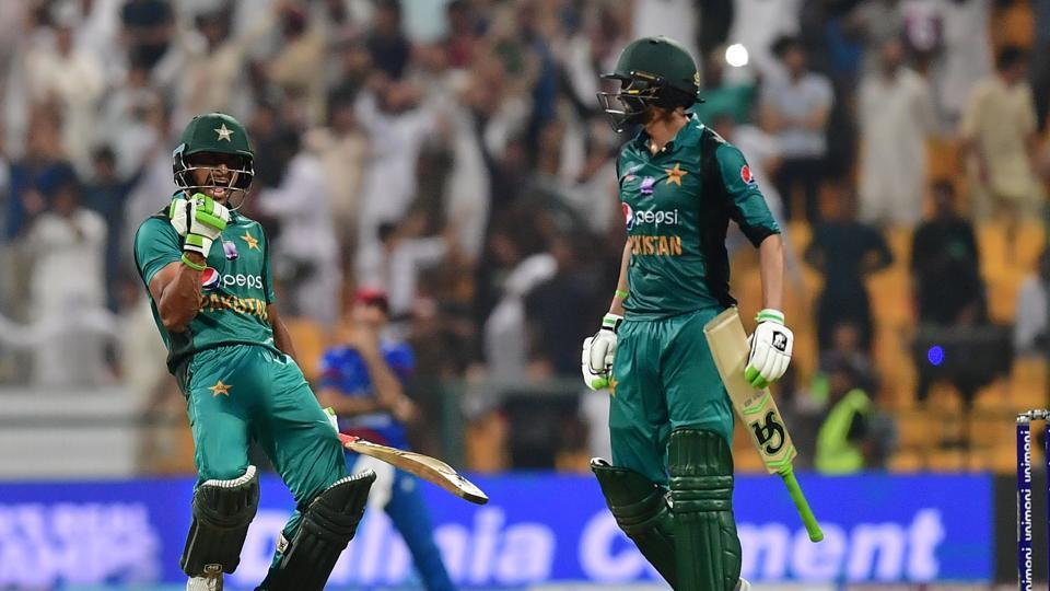 Pakistan's Hasan Ali (L) celebrates with Shoaib Malik at the end of the match during the one day international. (AFP)