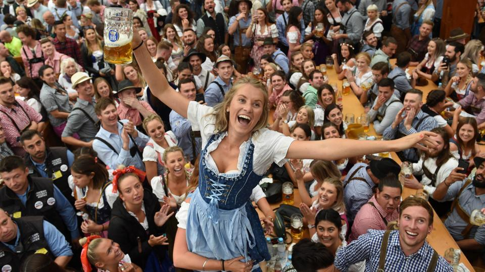 Visitors celebrate as they drink beer during the Munich's annual beer festival. (Christof Stache / AFP)