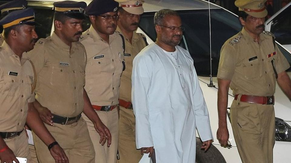 Bishop Franco Mulakkal (2nd R), accused of raping a nun, is escorted by police outside a crime branch office on the outskirts of Kochi in Kerala.