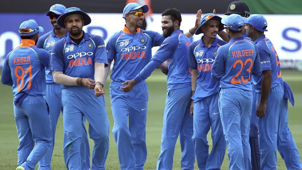 India's Ravindra Jadeja, center without cap, celebrates with teammates the dismissal of Bangladesh's Shakib Al Hasan.