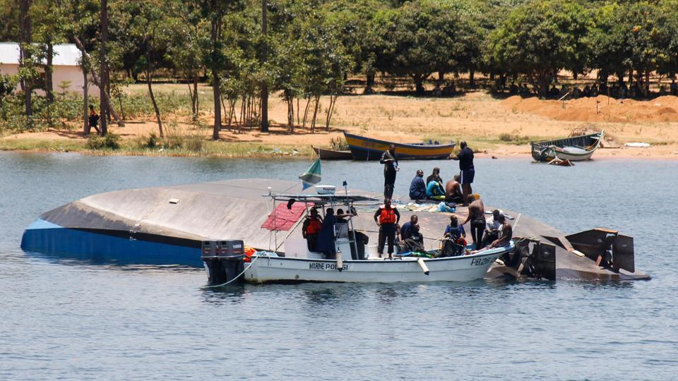 Divers rescue man from capsized Tanzanian ferry as death