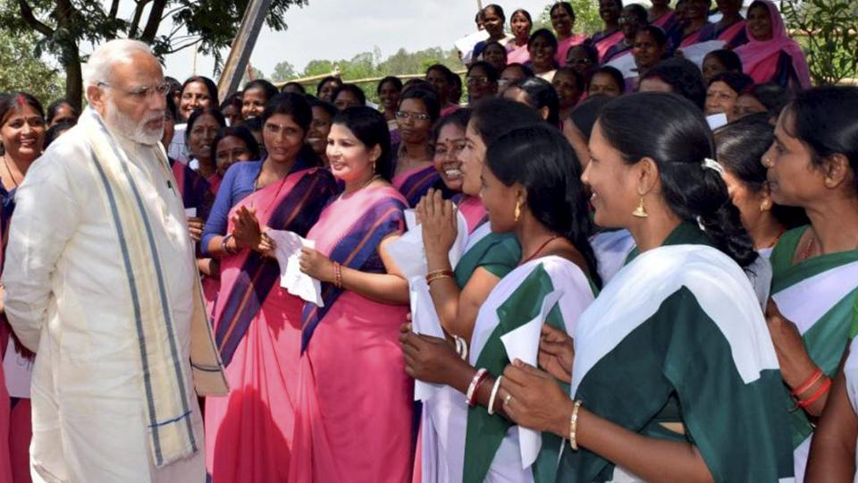 Prime Minister Narendra Modi meets with self help groups (SHG) Sahiya workers during the launch of Health Insurance Scheme in Ranchi, Sunday, Sept 23, 2018.