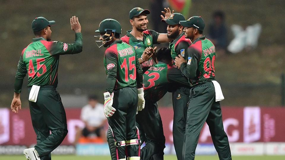 Bangladesh Nazmul Islam celebrates with his team after he dismissed Afghanistan batsman Rahmat Shah during the one day international (ODI) Asia Cup cricket match between Afghanistan and Bangladesh at The Sheikh Zayed Stadium in Abu Dhabi on September 23, 2018. (Photo by GIUSEPPE CACACE / AFP) (AFP)