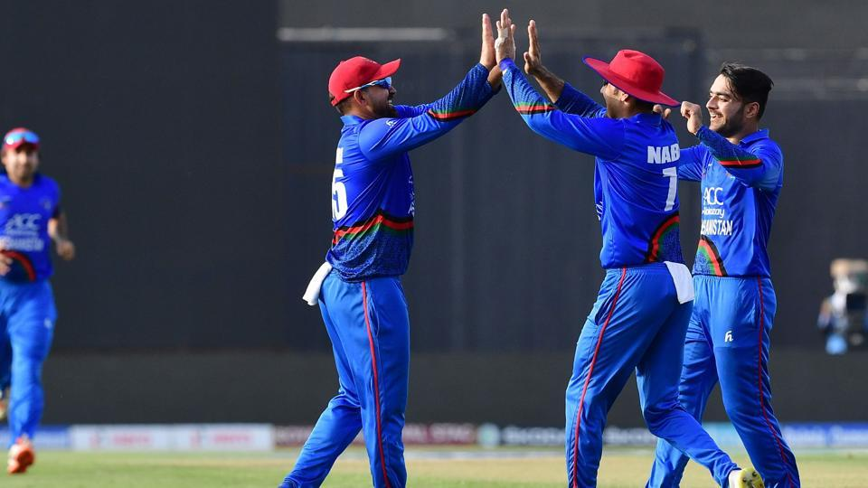 Afghanistan Samiullah Shinwari (2L) celebrates with teammates after he dismissed Bangladesh batsman Shakib Al Hasan during the one day international (ODI) Asia Cup cricket match between Afghanistan and Bangladesh at The Sheikh Zayed Stadium in Abu Dhabi on September 23, 2018. (Photo by GIUSEPPE CACACE / AFP) (AFP)
