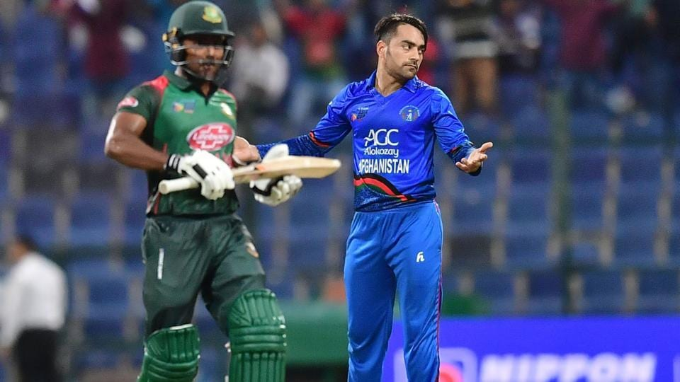 Afghanistan bowler Rashid Khan (R) reacts during the one day international (ODI) Asia Cup cricket match between Afghanistan and Bangladesh at The Sheikh Zayed Stadium in Abu Dhabi on September 23, 2018. (Photo by GIUSEPPE CACACE / AFP) (AFP)
