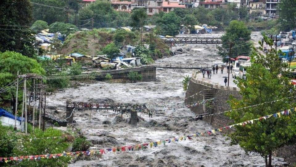 Beas river in spate after heavy rains in Himachal Pradesh's Kullu district on Monday.