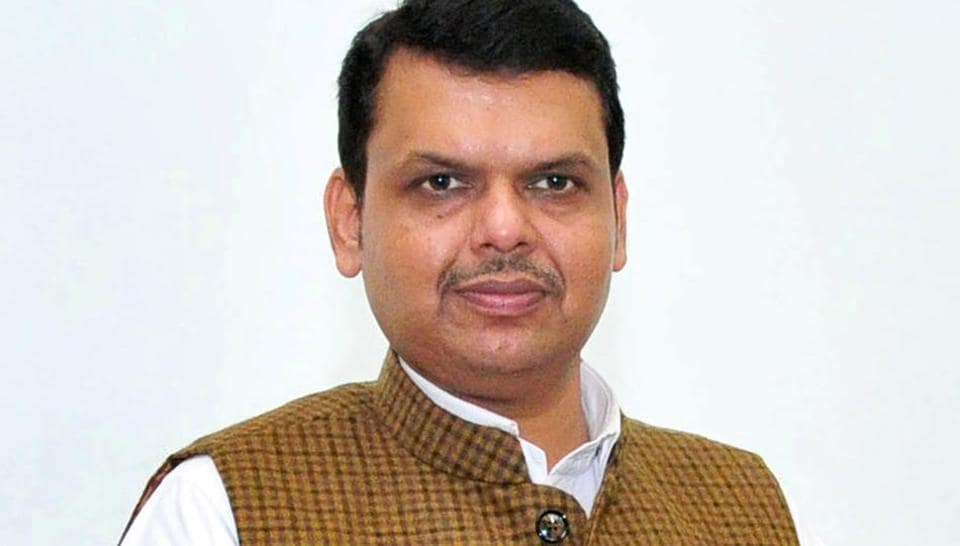 Maharashtra Chief Minister Devendra Fadnavis display the Maharashtra police citizens app which he inaugurated during a program in Nagpur, India.