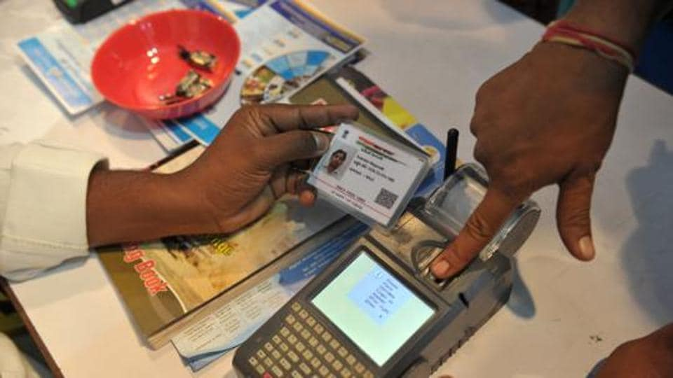 A visitor giving a thumb impression to withdraw money from his bank account with his Aadhaar card during a Digi Dhan Mela, held to promote digital payment, in Hyderabad.