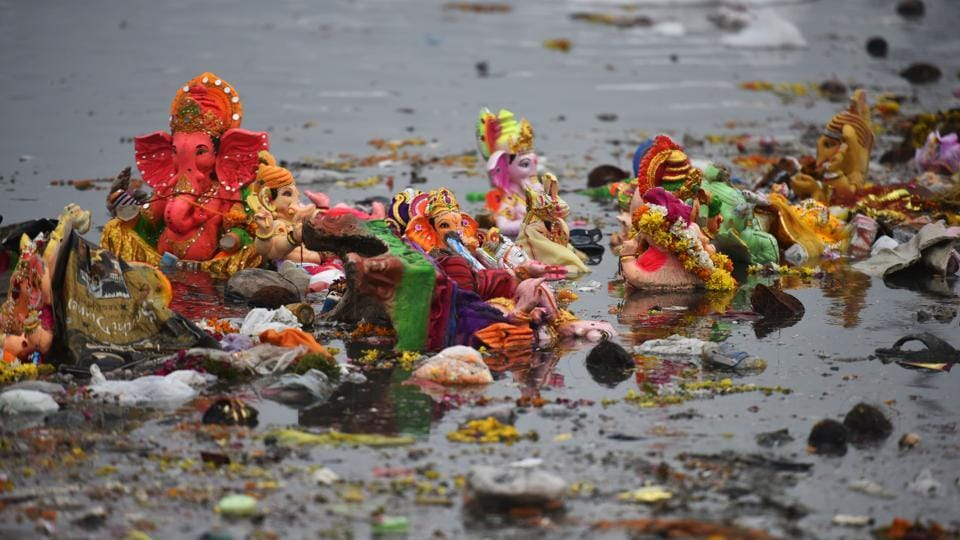 Ganesh idols are seen floating in the polluted Yamuna river after immersion of the idols on the last day of Ganesh Chaturthi , at ITO in New Delhi, India, on Monday, September 24, 2018.