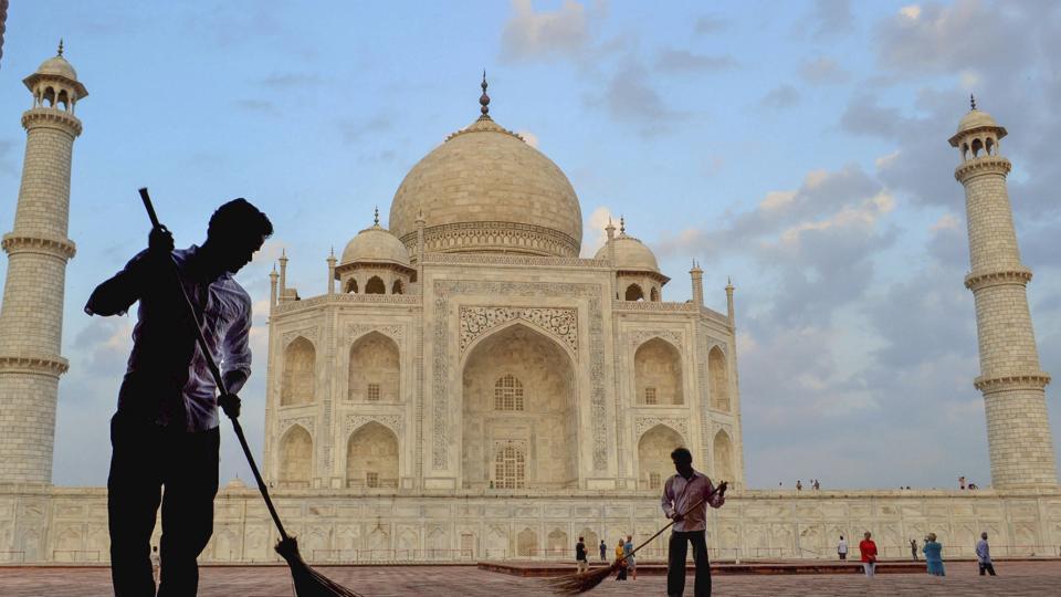 Workers sweep the premises of Taj Mahal under 'Swachhta hi Seva' campaign, in Agra.