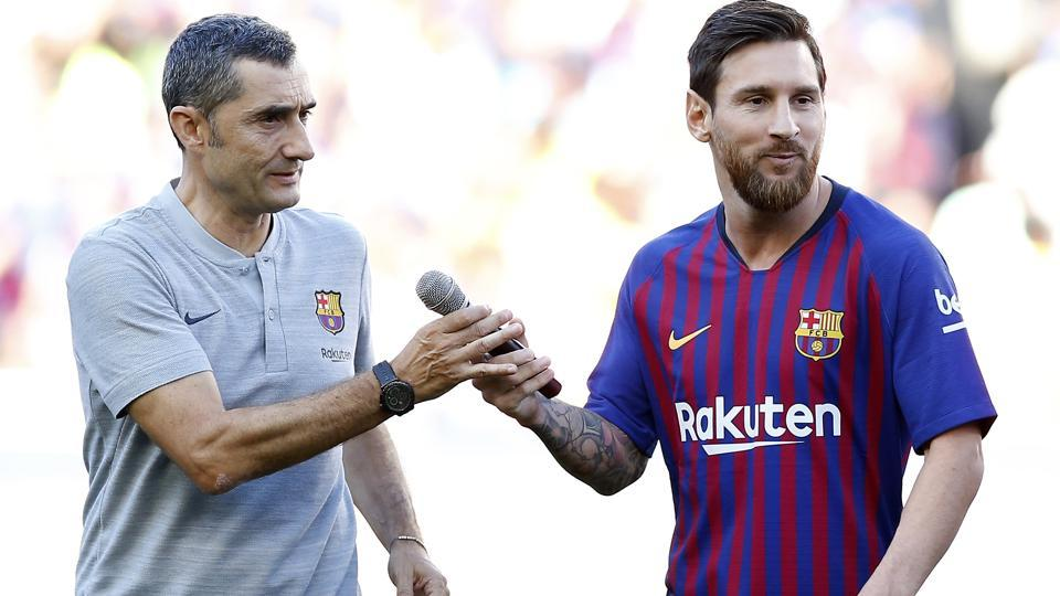 FC Barcelona's Lionel Messi, right, and coach Ernesto Valverde ahead of the Joan Gamper trophy friendly match.