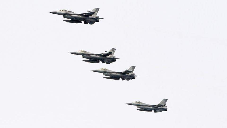 Taiwanese F-16 jet fighters fly in close formation during a navy exercise at Suao naval station in Yilan County, northeastern Taiwan. China demanded Tuesday, September 25, 2018, that the US cancel a $330 million sale of military equipment to Taiwan, warning of