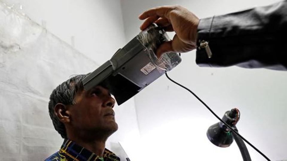 A man goes through the process of eye scanning for the Unique Identification database system, also known as Aadhaar, at a registration centre in New Delhi