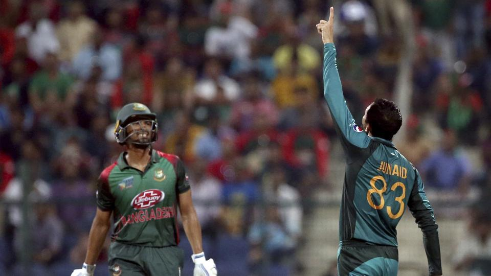 Pakistan's Junaid Khan, right, celebrates the dismissal of Bangladesh's Mahmudullah (AP)