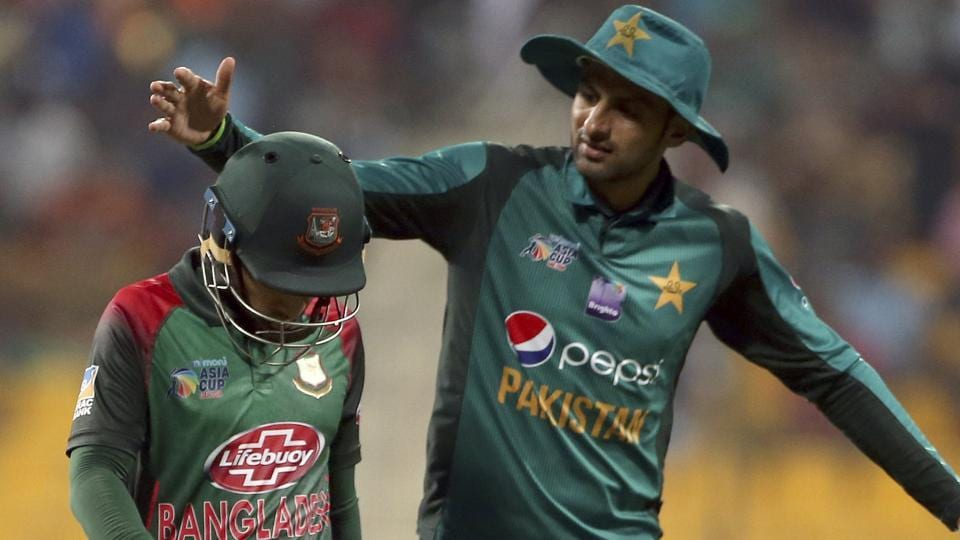 Pakistan's Shoaib Malik, right, pats Bangladesh's Mushfiqur Rahim on scoring 99 runs after Rahim's dismissal during the one day international. (AP)