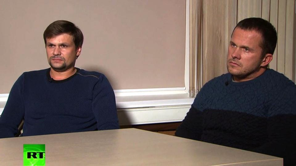 A screengrab taken on September 13, 2018, from footage broadcast by Russia's state broadcaster Russia Today (RT), shows two men, purported to be Alexander Petrov and Ruslan Boshirov taking part in a television interview.