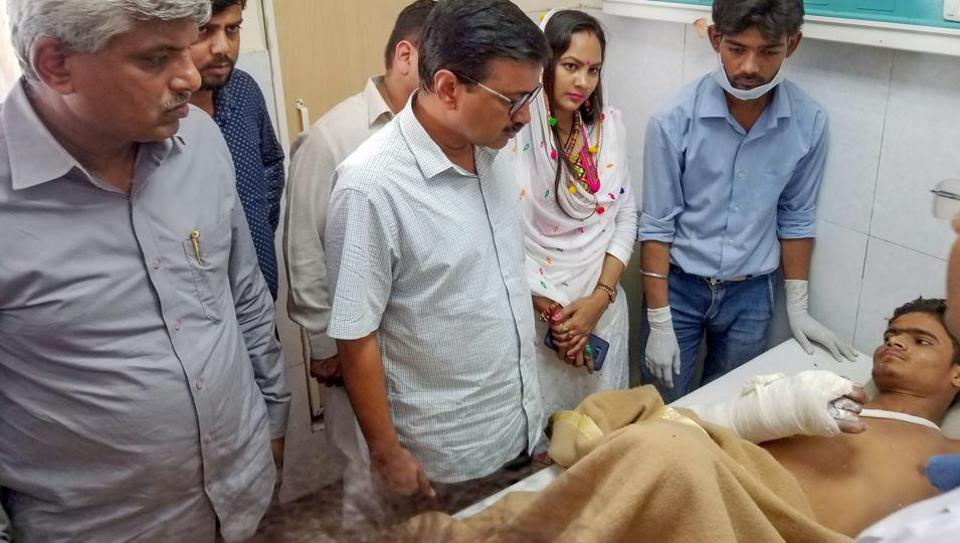Delhi Chief Minister Arvind Kejriwal visits a victim of a building collapse in Ashok Vihar, at a hospital in New Delhi, Wednesday, Sept 26, 2018.