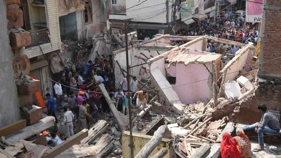 Rescue workers carry out the operation after a three-storey building collapsed at Ashok Vihar, in northwest Delhi, India, on Wednesday September 26, 2018.