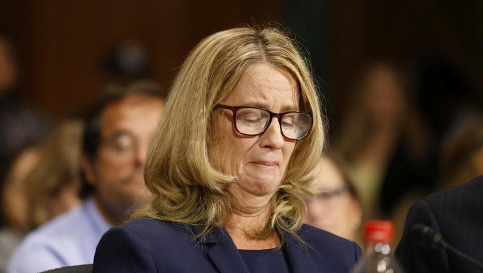 Christine Blasey Ford reacts as she speaks before the Senate Judiciary Committee hearing on the nomination of Brett Kavanaugh to be an associate justice of the Supreme Court of the United States, on Capitol Hill in Washington, DC.