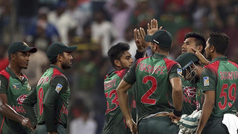 Bangladesh's wicketkeeper Liton Das, second right wearing helmet, celebrates with teammates. (AP)