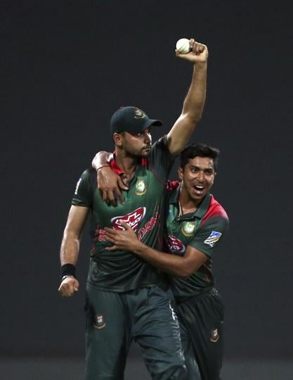 Bangladesh's captain Mashrafe Mortaza, left, holds the ball as he celebrates with teammate Soumya Sarkar the dismissal of Pakistan's Shoaib Malik. (AP)
