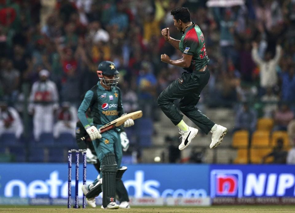 Bangladesh's Soumya Sarkar, right, leaps in the air to celebrate the dismissal of Pakistan's Shadab Khan. (AP)