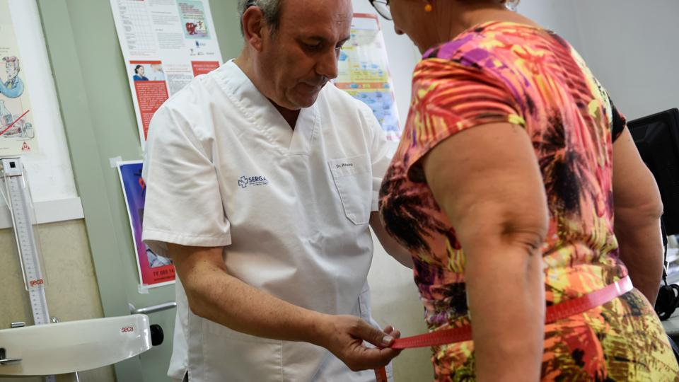 A 63-year-old family doctor Carlos Pineiro weighs a woman at the town's health centre in Naron, Spain. The town has set itself the ultimate weight loss challenge: by early 2020, its residents must shed 100,000 kilos. Gone are bacon and fried calamari from the diets of thousands of residents in Naron who are taking to sport again as part of a slimming programme that kicked off in January. (Miguel Riopa / AFP)