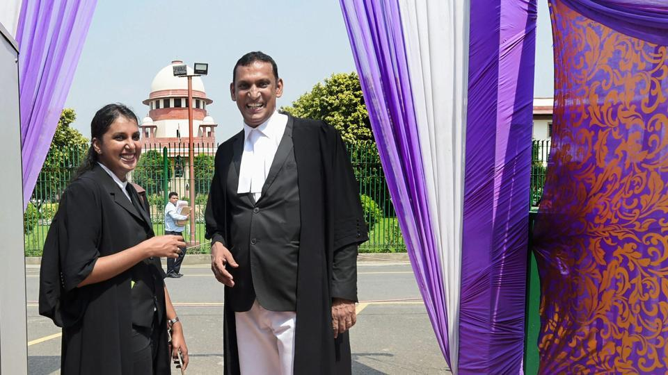 """Lawyer Kaleeswaram Raj and Thulasi K Raj leave after the Supreme Court verdict on adultery law. The apex court has scrapped adultery as a criminal offence, ruling that the 19-century law that """"treats a husband as the master', is unconstitutional. """"The adultery law is arbitrary and it offends the dignity of a woman,"""" Chief Justice of India Dipak Misra, who led the five-judge bench said. (Vijay Verma / PTI)"""