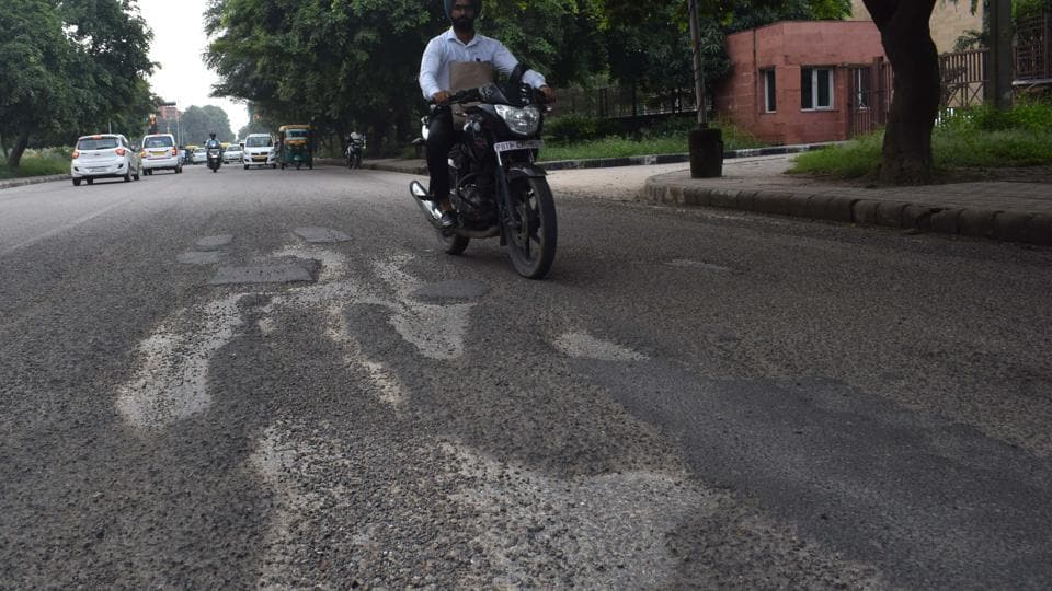 A dilapidated road in Sector 43, Chandigarh. During a random survey conducted by HT on Thursday, nearly half of the internal roads in Sector 43 were found riddled with potholes.