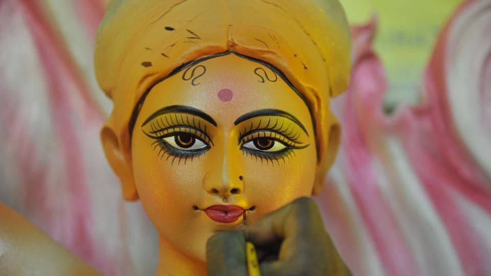 An artist gives the final touches to a statue of the goddess Durga ahead the forthcoming Dushhera-Vijaya Dashami festival at a workshop in Hyderabad, Telangana. (Noah Seelam / AFP)
