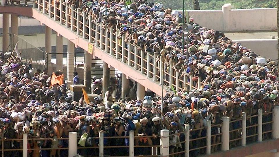 "No woman can be stopped from entering Sabarimala temple, the Supreme Court ruled on Friday, ending a traditional ban on the entry of women between 10 and 50 years of age to the hilltop shrine in Kerala. ""Religion can't become a cover to exclude and deny basic right to worship... nor can physiology be a reason,"" the top court's five judge bench said in a 4:1 majority verdict. (Dipak Kumar / REUTERS File)"