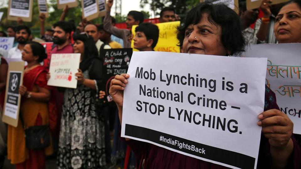 People shout anti-government slogans during a protest against what the demonstrators say are recent mob lynchings across the country, in Ahmedabad, in July 2018.